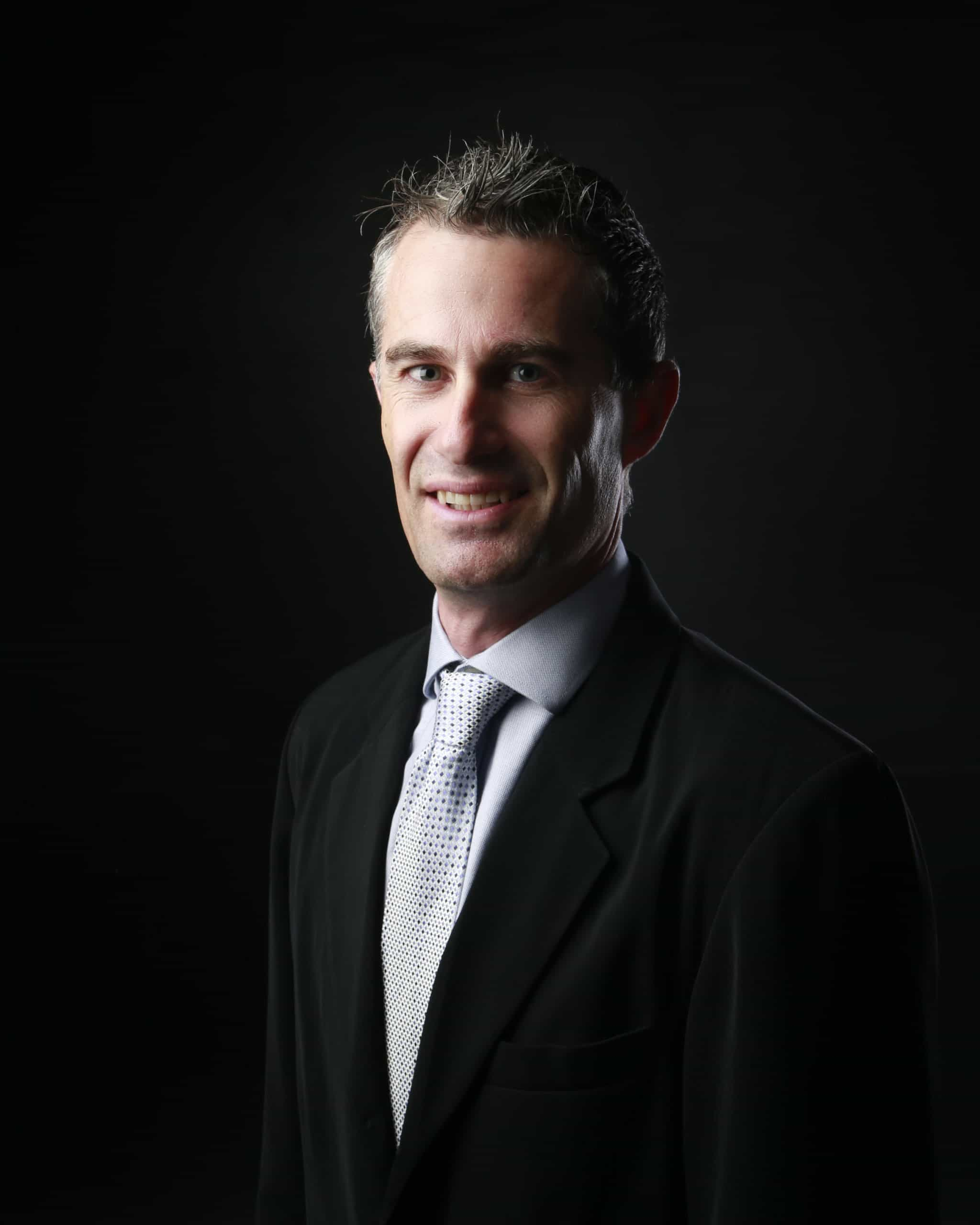 A headshot of Simon Booth, the director of Radiation Services WA